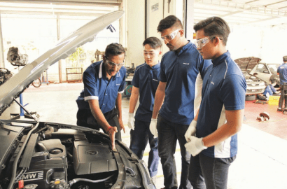 School of Skills head trainer Daneshwaran Krishnasamy (left) explaining to students the inner functions of a motor engine.